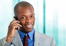 Businessman talking at phone Stock Images