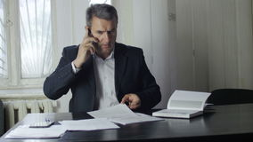 Businessman talking on the phone stock video footage