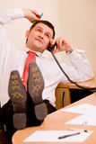 Businessman talking by phone Stock Photos