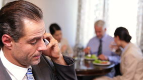 Businessman talking on phone at business lunch Stock Photo
