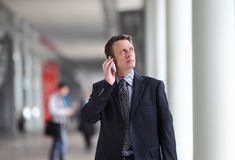 Businessman talking on the phone during a business travel stock image