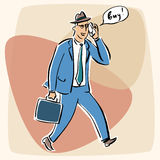 Businessman talking on the phone bye Royalty Free Stock Images