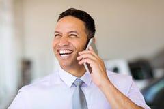 Businessman talking phone stock image