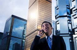 Businessman Talking on Phone in the City Royalty Free Stock Image