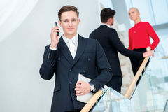 Businessman talking on the phone with a client. Young businessma Royalty Free Stock Images