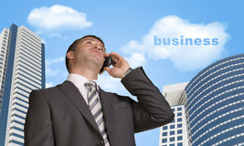 Businessman talking on the phone. Cloud with word Stock Photography