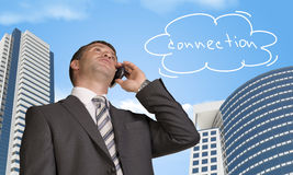 Businessman talking on the phone. Cloud with word Stock Image