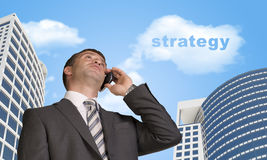 Businessman talking on the phone. Cloud with word Stock Photo