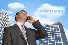 Businessman talking on the phone. Cloud with word Royalty Free Stock Image