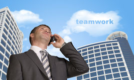 Businessman talking on the phone. Cloud with word Stock Images