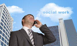 Businessman talking on the phone. Cloud with words Royalty Free Stock Photo