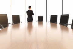 Businessman talking on the phone and conference table with chair Stock Image
