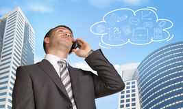 Businessman talking on the phone. Coud with Stock Photography