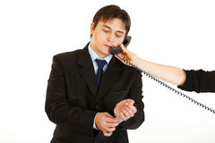 Businessman talking on phone in hand of secretary Royalty Free Stock Image