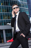 Businessman talking on the phone and holding his Royalty Free Stock Photos
