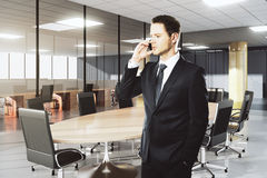 Businessman talking on the phone in modern conference room Stock Image