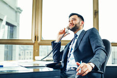 Businessman talking on the phone at the office Stock Images
