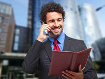 Businessman talking at the phone outdoor Royalty Free Stock Photography