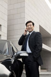 Businessman talking on phone outdoors Stock Photography