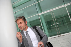 Businessman talking on phone outdoors Royalty Free Stock Image