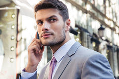 Businessman talking on the phone outdoors Stock Images