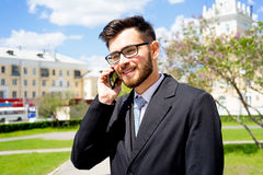 Businessman is talking on phone. Outside the office Stock Image