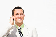 Businessman talking on the phone. Portrait of a young businessman talking on the phone Royalty Free Stock Photo