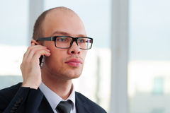 Businessman talking by the phone Royalty Free Stock Photos