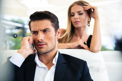 Businessman talking on the phone in restaurant Royalty Free Stock Photos