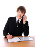 Businessman is talking on the phone and sign docs Royalty Free Stock Images
