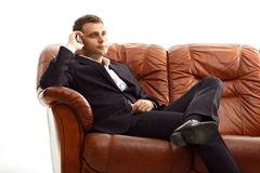 Businessman talking phone sitting on the couch Royalty Free Stock Photo
