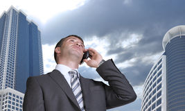 Businessman talking on the phone. Skyscrapers and Stock Photography