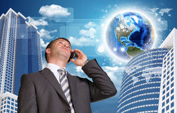 Businessman talking on the phone. Skyscrapers and Stock Images