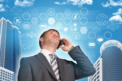 Businessman talking on the phone. Skyscrapers and Stock Photo