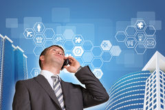 Businessman talking on the phone. Skyscrapers and Royalty Free Stock Photography