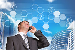 Businessman talking on the phone. Skyscrapers and Royalty Free Stock Photos