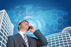 Businessman talking on the phone. Skyscrapers, sky Royalty Free Stock Photography