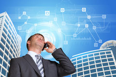 Businessman talking on the phone. Skyscrapers, sky Royalty Free Stock Images