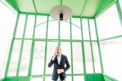Businessman in the green hall Royalty Free Stock Photos