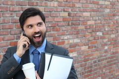 Businessman talking on the phone with surprise Royalty Free Stock Images
