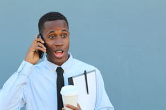 Businessman talking on the phone with surprise Stock Image