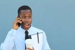 Businessman talking on the phone with surprise Stock Photos
