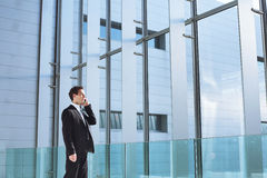 Businessman talking by phone Stock Image