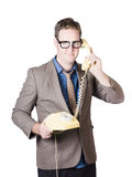 Businessman talking on retro telephone Stock Photo