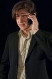 Businessman talking on smart-phone Stock Photos