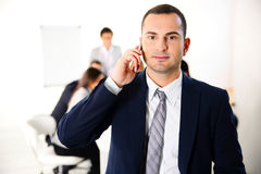 Businessman talking on the smartphone Stock Image