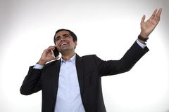 Businessman talking on smartphone Stock Images