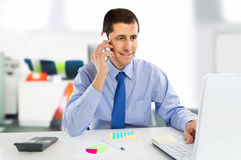 Businessman talking by smartphone at the office Stock Image
