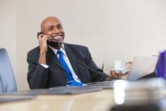Businessman talking on telephone Stock Image