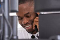 Businessman Talking On Telephone. Close-up Of Happy Young Businessman Talking On Telephone Royalty Free Stock Photography